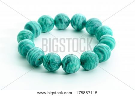 Beautiful Amazonite or Amazon stone beads in bracelet on white background
