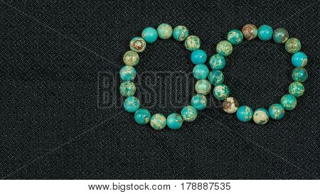 Variscite Round Bead Stretchy Bangle Bracelet on black Thai silk background