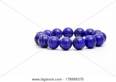 Beautiful high grade royal blue Lapis lazuli beads in bracelet on white background