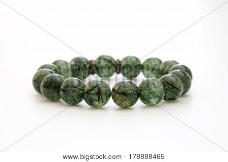 Beautiful natural rare greenish Rutile Quartz Gemstone Bead Bracelet on white background