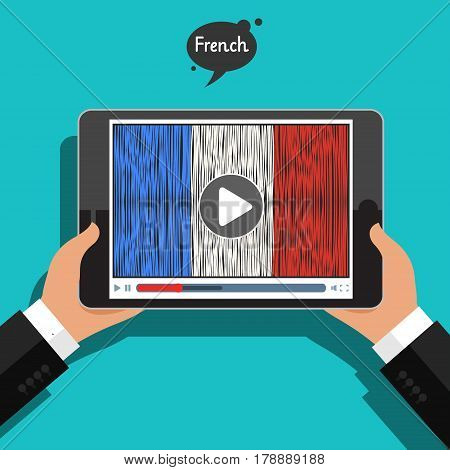 Concept of learning languages. Study French. Hand drawn French flag on the tablet screen. Film in French.