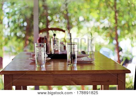 Interior wooden table and chair and nature green garden background