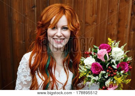 Boho Bride With Red Hair Posing