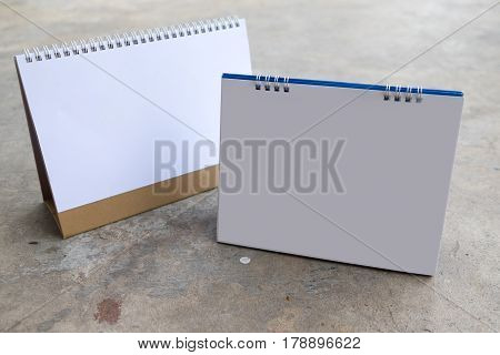 Blank table calendar on a concrete background