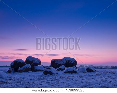 Dolmen with snow cover in winter landscape
