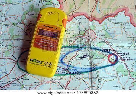 Geiger counter.Back-Map of Ukraine  with location of Balakleya .Place of arsenal explosion at 23 march. 138 kT. of TNT power.March 25 ,2017 in Kiev, Ukraine