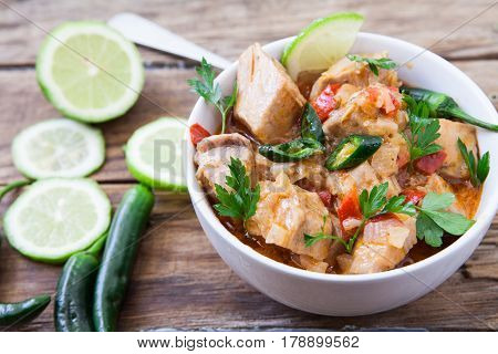 Red Thai tuna curry with green chili pepper