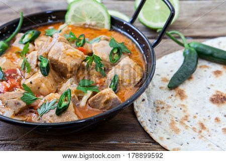 tuna curry with green chili pepper and naan bread