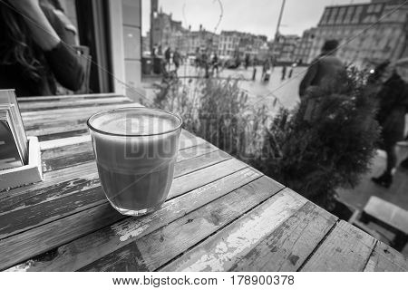 Coffee on a table in a coffe shop window.