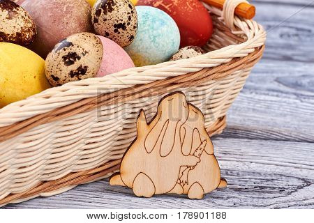Easter basket and plywood rabbits. Chicken and quail egg pile. Cute art ideas.