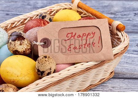 Eggs and Happy Easter tag. Light colored woven basket. How to prepare for Easter.