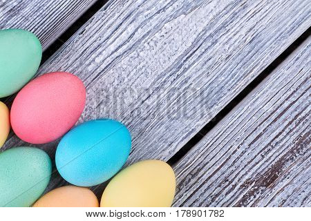 Bright Easter eggs on wood. Colored chicken eggs close up.