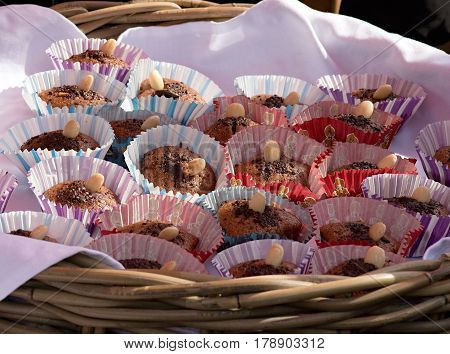 Freshly baked muffins with almonds ready for sale at a local farmers' market