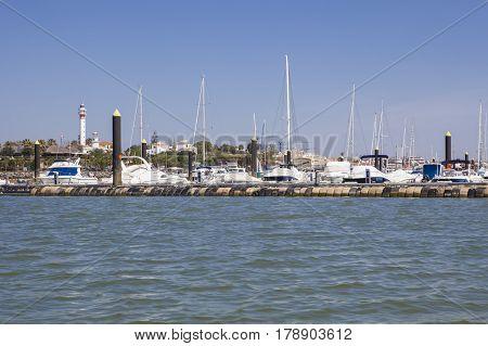 El Rompido marina and town seen from River Piedras water Huelva Cartaya Spain