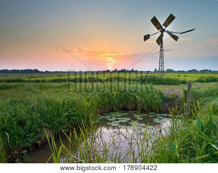 Old Windmill In Agricultural Area In The Netherlands