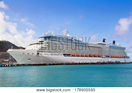 PHILISBURG,ST. MARTEEN - APRIL 16,2015:  Cruise ship Celebrity Silhouette, docked at Philisburg, St. Marteen harbor on a clear sunny day.