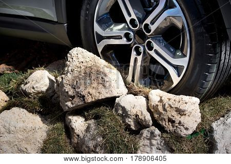 Close up of off-road vehicle wheel on extreme mountain terrain