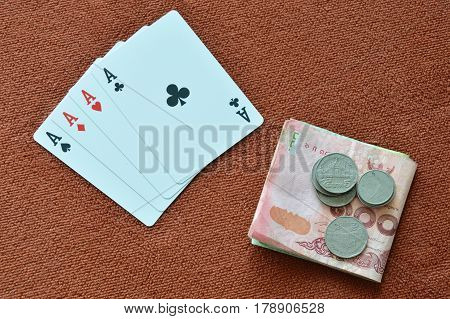 playing card showdown ace and money on table