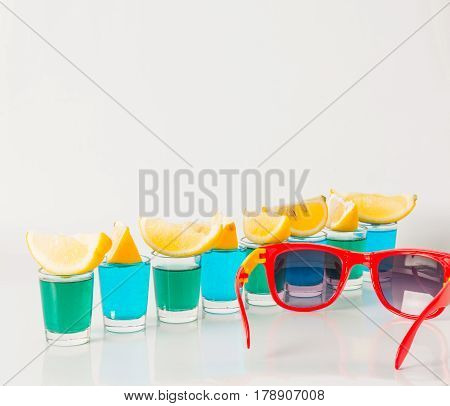 Glasses With Blue And Green Kamikaze, Glamorous Drinks, Mixed Drink Poured Into Shot Glasses, Sungla