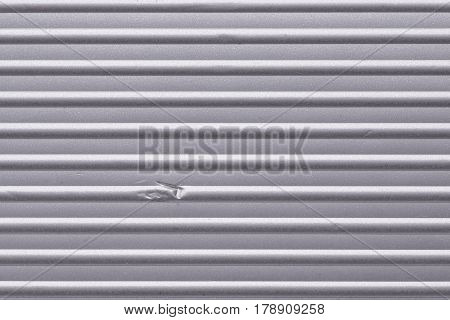 Corrugated Metallic Surface With Dent