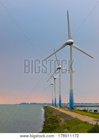 Windturbines On A Pier