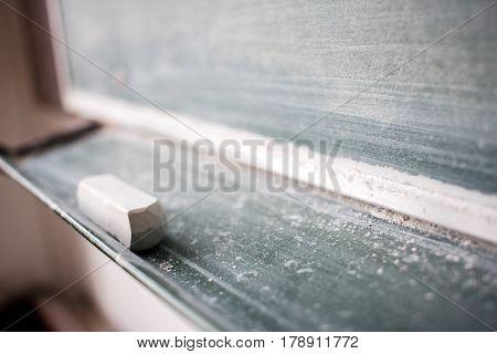 Piece Of Chalk Under Blackboard. Soft, Shallow Focus