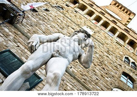 Michelangelo's David statue located in Piazza della Signoria in Florence, Italy.Palazzo Vecchio, the town hall of Florence and also an art museum. Florence, Italy
