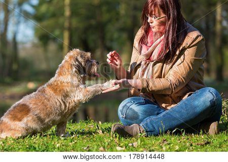 Woman Gives Dog A Treat And Gets The Paw