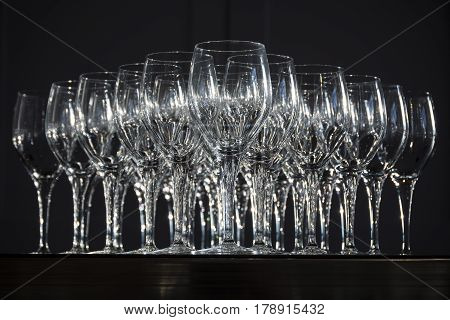 Wine glasses arranged ready to use against black background