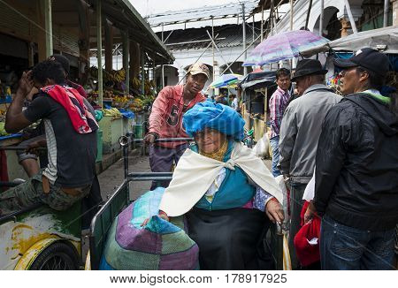 Otavalo Ecuador - February 1 2014: People in a market in the town of Otavalo in Ecuador.