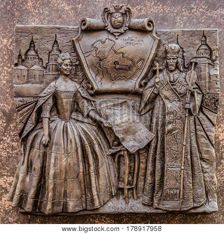 Belgorod Russia -October 08 2016: Historical bas-relief in Belgorod the obelisk of military glory depicting the creation of the Belgorod governorate in 1727 in the image of Empress Catherine I to the decree. Right - Bishop Ioasaph.