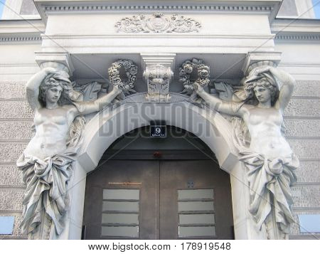 VIENNA, AUSTRIA - AUGUST 15, 2016: Antique sculpture at the house apartment building entrance door in Vienna, Austria. Old town Wien traditional european art detail