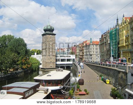 PRAGUE, CZECH REPUBLIC - AUGUST 17, 2016: Masarykovo embankment, Vltava river in Prague, Czech Republic. Popular landmark of Czech capital city with floating restaurant boats on the Vltava river.