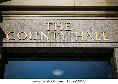 County Hall sign above doorway in gold lettering