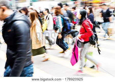 picture made with motion blur of people crossing a street in Hongkong poster