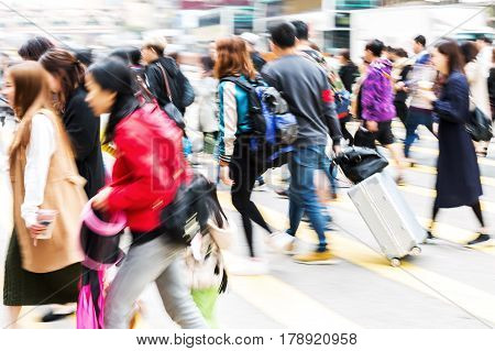 People Crossing A Street In Hongkong