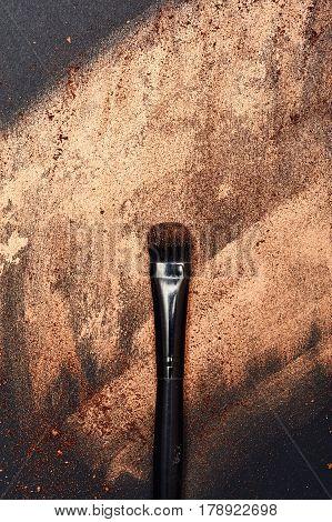Beauty black Brush on golden powdered Background