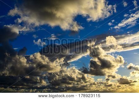 Blue afternoon sky with hazy clouds background