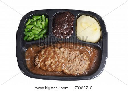 isolated salisbury steak tv dinner with brownie