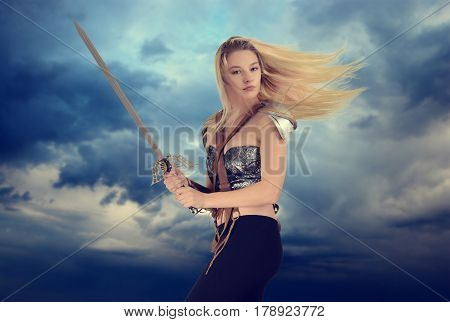 portrait of woman warrior with cloudy sky background