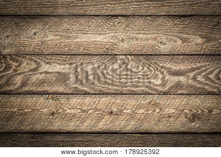 rustic wooden background - planks of weathered pine wood with strong grain pattern and knots