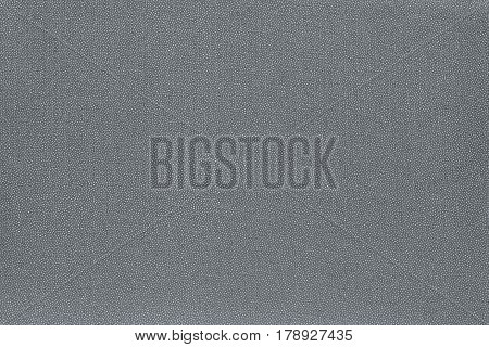 abstract speckled texture and background of textile material or fabric of silvery color