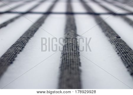 snow on the roof of asbestos. Single focus.