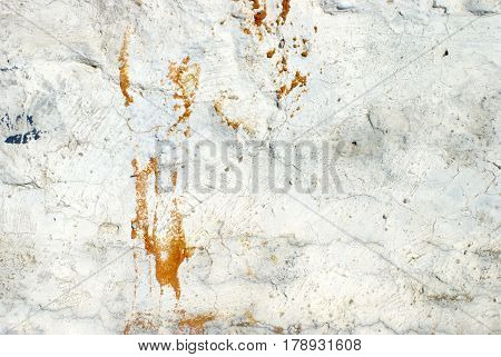 Closeup view of a messy construction wall with abstract textures and colors to use as a design element in various projects.