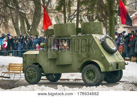 Lviv Ukraine - January 29 2017: Military historical reconstruction battle of Kruty. Armored car Fiat Izhora attacking position during reconstruction.