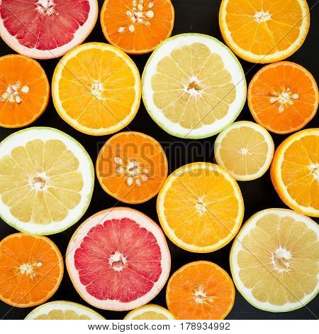 Lemon, orange, mandarin, grapefruit and sweetie isolated on black background. Flat lay, top view. Fruit background