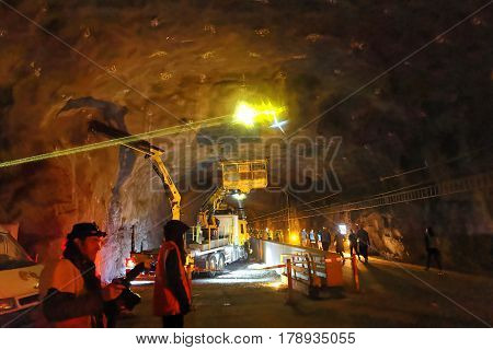 STOCKHOLM SWEDEN - MAR 25 2017: Tunnel with yellow laser show in the ceiling a truck and runners in the Stockholm Tunnel Run Citybanan 2017. March 25 2017 in Stockholm Sweden