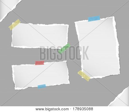 Different size white note, notebook, copybook sheets, strips stuck with colorful sticky tape on gray background.