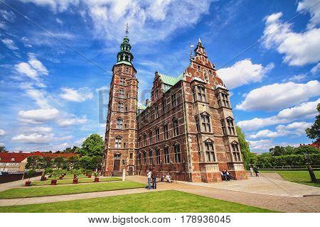 COPENHAGEN DENMARK - JUNE 15: Rosenborg castle in Copenhagen and park around. Rosenborg castle in Kongens Have - Rosenborg King's garden in 2012
