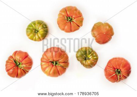 An overhead photo of Spanish Raf tomatoes on a white background with a place for text